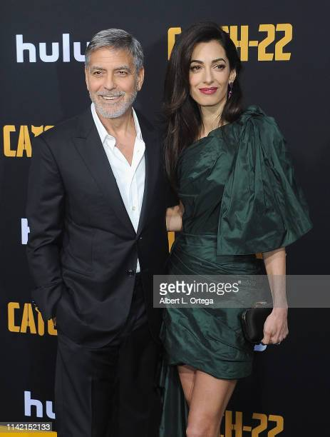 """George Clooney and Amal Clooney arrive for the U.S. Premiere Of Hulu's """"Catch-22"""" held at TCL Chinese Theatre on May 7, 2019 in Hollywood, California."""