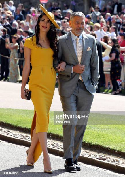 George Clooney and Amal Clooney arrive for the wedding ceremony of Britain's Prince Harry and US actress Meghan Markle at St George's Chapel Windsor...