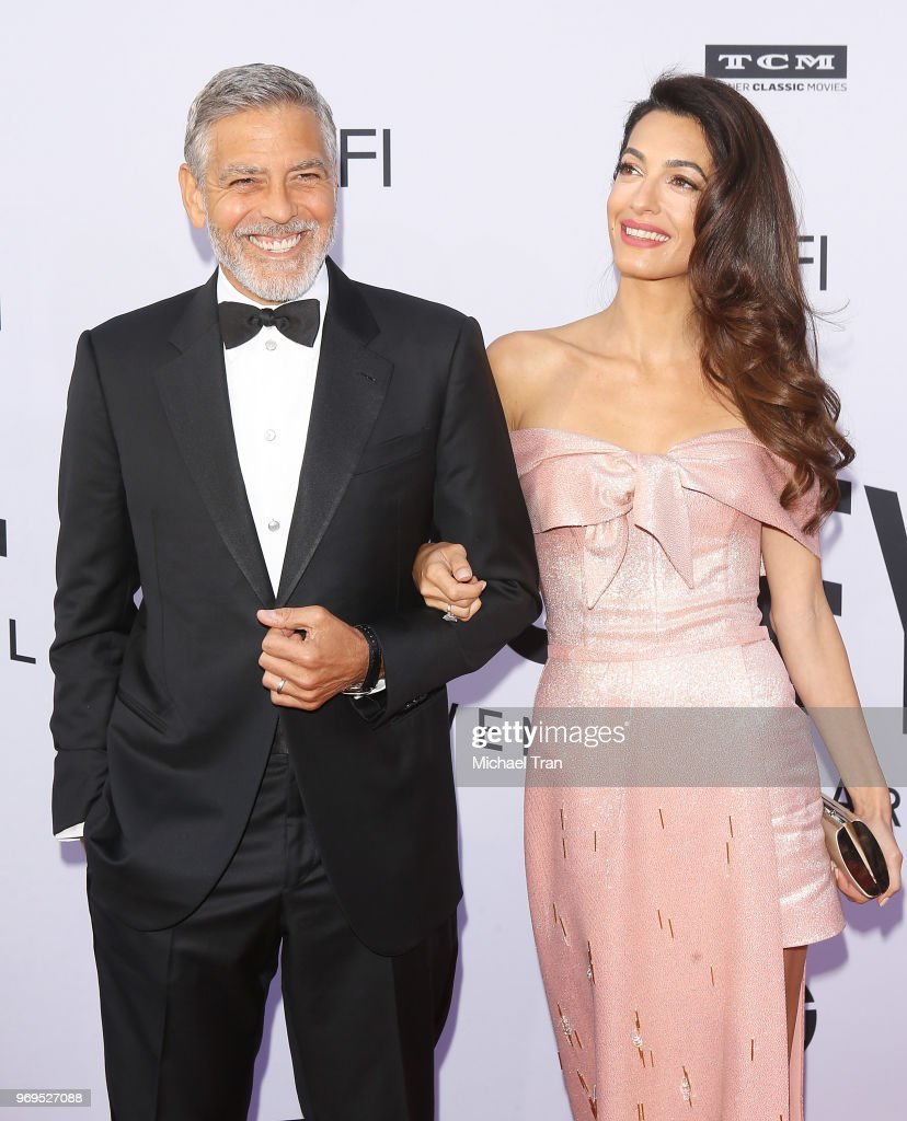 George Clooney and Amal Clooney arrive to the American Film Institute's 46th Life Achievement Award Gala Tribute held on June 7, 2018 in Hollywood, California.