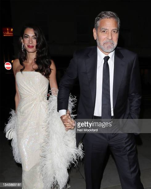 George Clooney and Amal Clooney arriving at a restaurant ahead of the BFI 'The Tender Bar' premiere on October 10, 2021 in London, England.