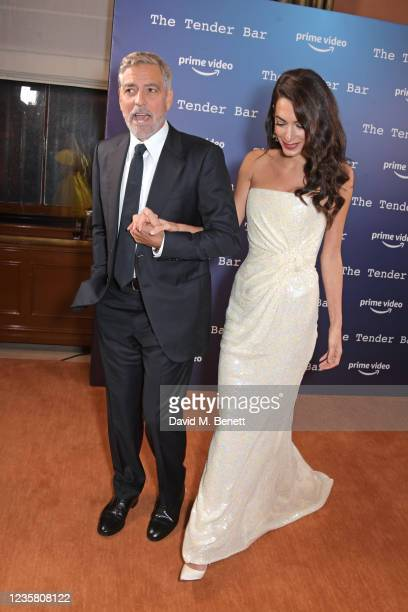 """George Clooney and Amal Clooney attend a photocall for """"The Tender Bar"""" during the 65th BFI London Film Festival at NoMad London on October 10, 2021..."""