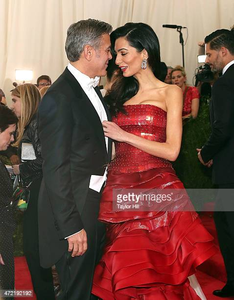George Clooney and Amal Clooney attend 'China Through the Looking Glass' the 2015 Costume Institute Gala at Metropolitan Museum of Art on May 4 2015...