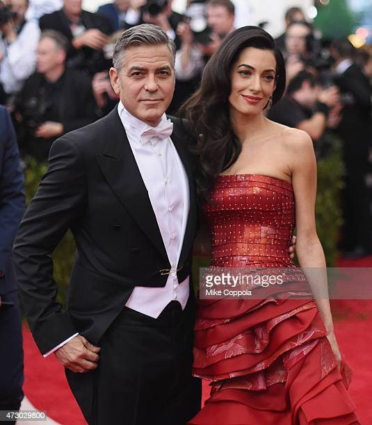 George Clooney and Amal Clooney attend the China Through The Looking Glass Costume Institute Benefit Gala at the Metropolitan Museum of Art on May 4...