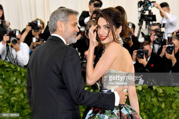 George Clooney and Amal Clooney attend the Heavenly Bodies Fashion The Catholic Imagination Costume Institute Gala at The Metropolitan Museum of Art...