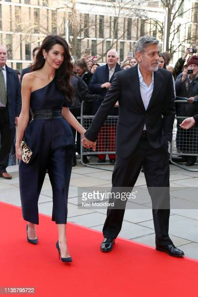 George Clooney and Amal Clooney attend the People's Postcode Lottery Charity Gala at McEwan Hall on March 14 2019 in Edinburgh Scotland