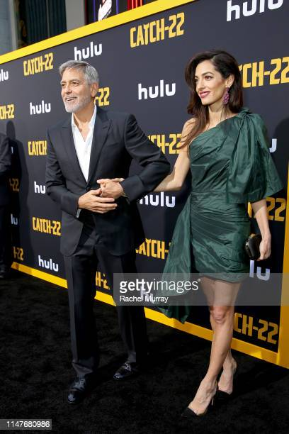 """George Clooney and Amal Clooney attend the premiere of Hulu's """"Catch-22"""" on May 07, 2019 in Hollywood, California."""