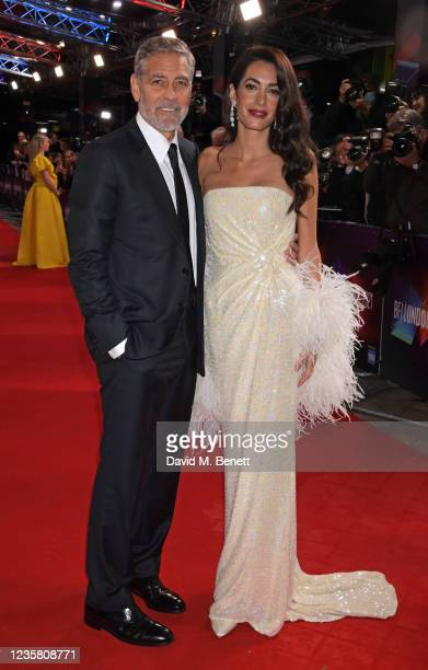 """George Clooney and Amal Clooney attend the Premiere of """"The Tender Bar"""" during the 65th BFI London Film Festival at The Royal Festival Hall on..."""