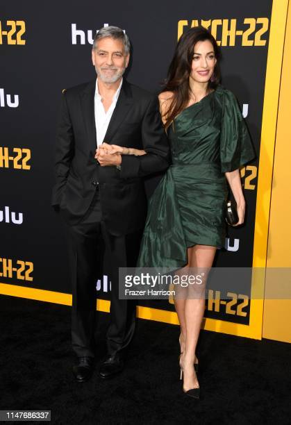 R George Clooney and Amal Clooney attend the US Premiere Of Hulu's Catch22 at TCL Chinese Theatre on May 07 2019 in Hollywood California
