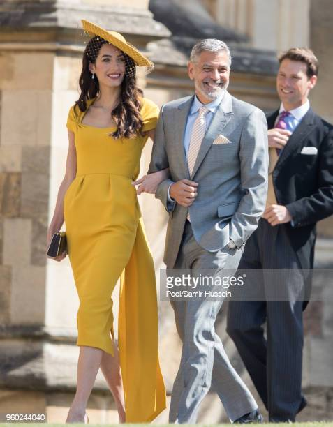 George Clooney and Amal Clooney attend the wedding of Prince Harry to Ms Meghan Markle at St George's Chapel Windsor Castle on May 19 2018 in Windsor...