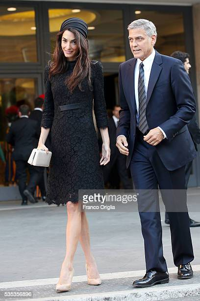 George Clooney and Amal Clooney leave at the end of 'Un Muro o Un Ponte' Seminary held by Pope Francis at the Paul VI Hall on May 29 2016 in Vatican...