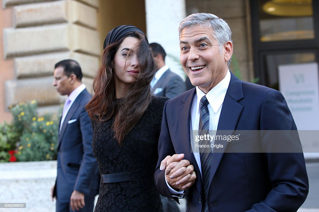 George Clooney and Amal Clooney leave at the end of 'Un Muro o Un Ponte' Seminary held by Pope Francis at the Paul VI Hall on May 29, 2016 in Vatican City, Vatican.