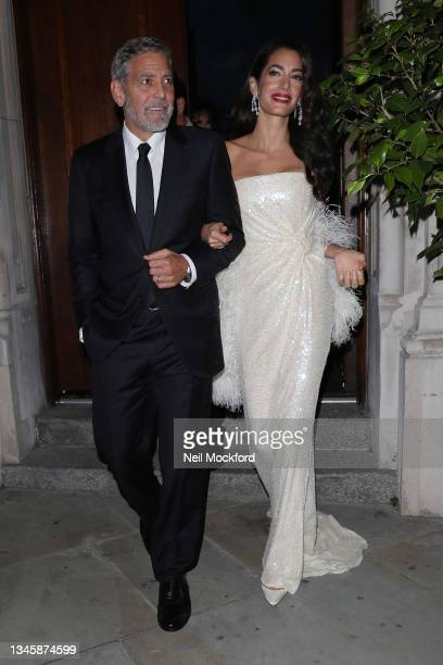George Clooney and Amal Clooney leaving The Nomad Hotel ahead of the BFI 'The Tender Bar' premiere on October 10, 2021 in London, England.