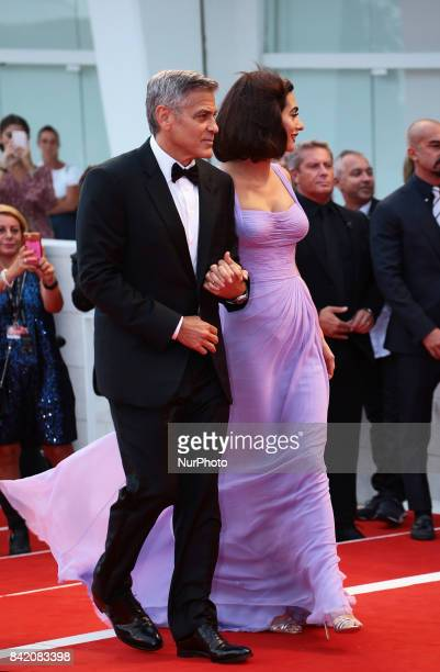 George Clooney and Amal Clooney walks the red carpet ahead of the 'Suburbicon' screening during the 74th Venice Film Festival in Venice Italy on...