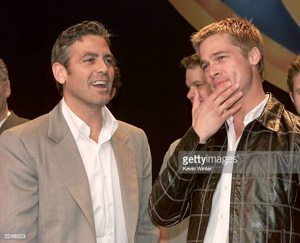 George Clooney and Brad Pitt at the Warner Bros luncheon at ShoWest Paris Hotel Las Vegas nv 3/8/01