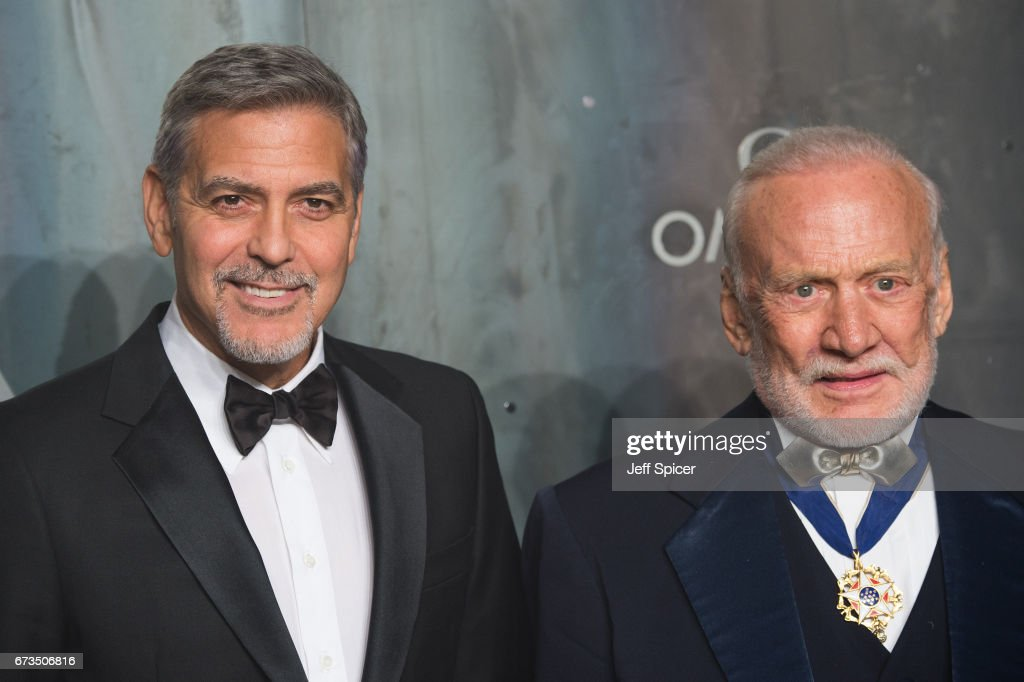 George Clooney and Buzz Aldrin attend the Lost In Space event to celebrate the 60th anniversary of the OMEGA Speedmaster, which has been worn by every piloted NASA mission since 1965 at Tate Modern on April 26, 2017 in London, United Kingdom.