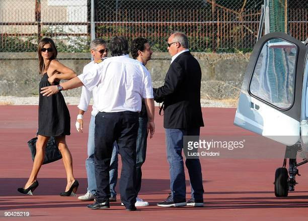 George Clooney and his girlfriend Elisabetta Canalis arrive by helicopter during the 66th Venice Film Festival on September 7 2009 in Venice Italy