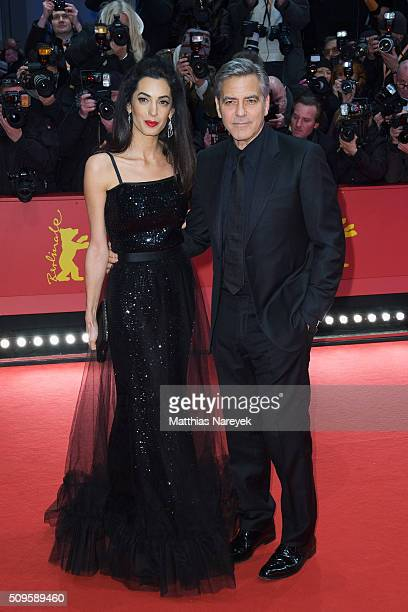 George Clooney and his wife Amal attend the 'Hail Caesar' premiere during the 66th Berlinale International Film Festival Berlin at Berlinale Palace...