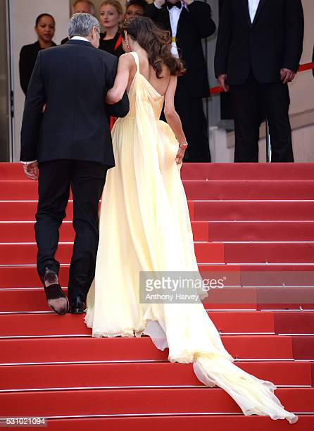 George Clooney and his wife Amal Clooney attend the 'Money Monster' premiere during the 69th annual Cannes Film Festival at the Palais des Festivals...