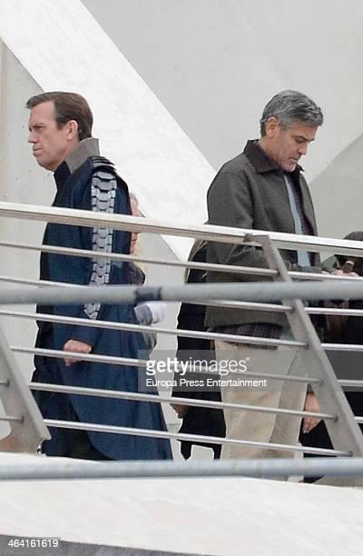 George Clooney and Hugh Laurie are seen on set filming 'Tomorrowland' at Ciudad de las Artes y las Ciencias on January 21 2014 in Valencia Spain