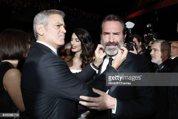 George Clooney and Jean Dujardin attend Cesar Film Award 2017 at Salle Pleyel on February 24 2017 in Paris France