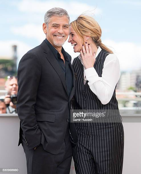 George Clooney and Julia Roberts attend the Money Monster Photocall at the annual 69th Cannes Film Festival at Palais des Festivals on May 12 2016 in...