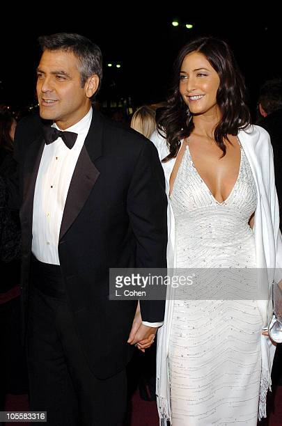 George Clooney and Lisa Snowdon during Ocean's Twelve Los Angeles Premiere Red Carpet at Grauman's Chinese Theater in Los Angeles California United...