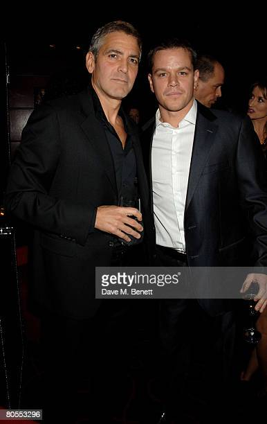 George Clooney and Matt Damon attend the Harpers Bazaar dinner for George Clooney hosted by editor Lucy Yeomans at L'Atelier de Joel Robuchon on...
