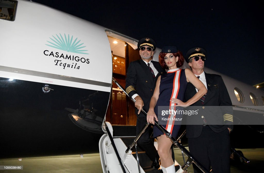 George Clooney And Rande Gerber Take Over The Controls En Route To Las Vegas For Round Two of the Casamigos Halloween Party : News Photo