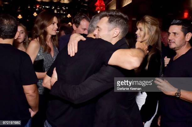George Clooney and Ryan Seacrest at the Casamigos House of Friends Dinner on June 8 2018 in Hollywood California