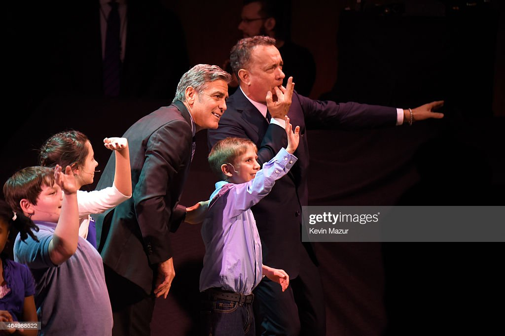 George Clooney and Tom Hanks onstage with SeriousFun campers at the SeriousFun Children's Network 2015 New York Gala: An Evening Of SeriousFun Celebrating the Legacy Of Paul Newman at Avery Fisher Hall at Lincoln Center for the Performing Arts on March 2, 2015 in New York City.