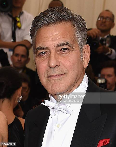 George Clooney attends the China Through The Looking Glass Costume Institute Benefit Gala at the Metropolitan Museum of Art on May 4 2015 in New York...