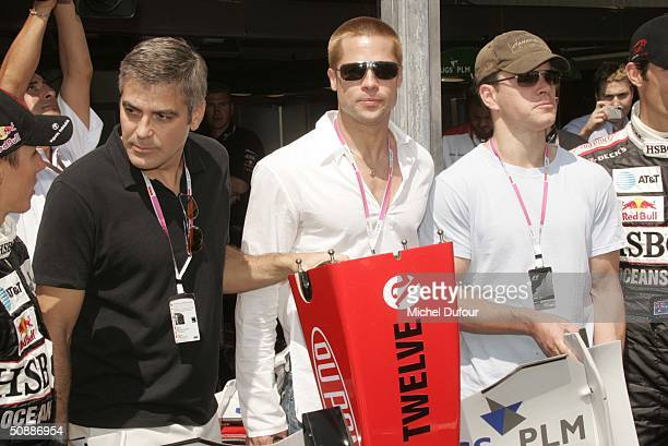 George Clooney, Brad Pitt and Matt Damon take a guided tour of the Jaguar garage as the official guests of Jaguar Racing during a photo-call to...