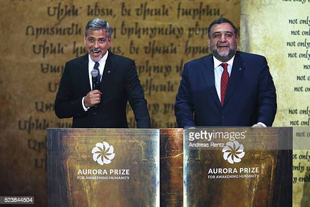George Clooney CoChair of the Selection Committee and Aurora Prize CoFounder Ruben Vardanyan honor Aurora Prize Laureate Marguerite Barankitse and...