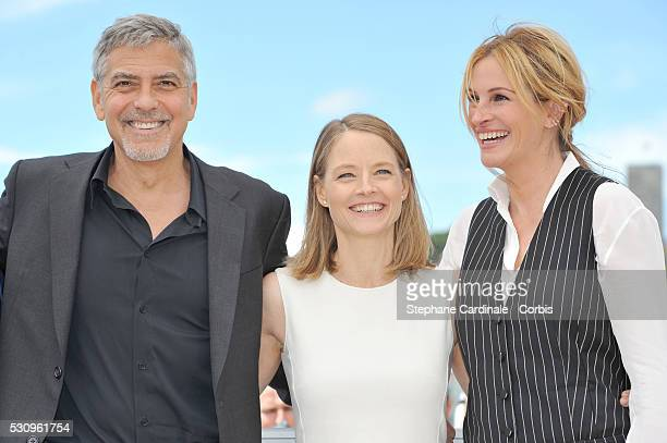 George Clooney director Jodie Foster and Julia Roberts attend the Money Monster photocall during the 69th annual Cannes Film Festival at the Palais...