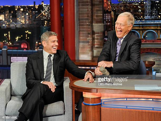 George Clooney handcuffs himself to Dave in an attempt to keep Dave from leaving the show on the Late Show with David Letterman Thursday May 14 2015...