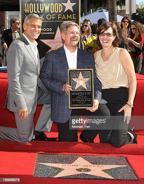 George Clooney John Wells and Allison Janney attend the ceremony honoring John Wells with a Star on The Hollywood Walk of Fame held on January 12...