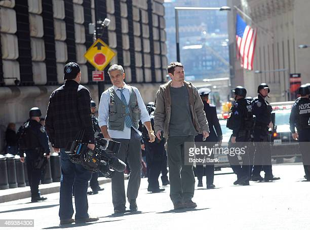 George Clooney Lenny Venito and Jack O'Connell on the set of 'Money Monster' on April 11 2015 in New York City