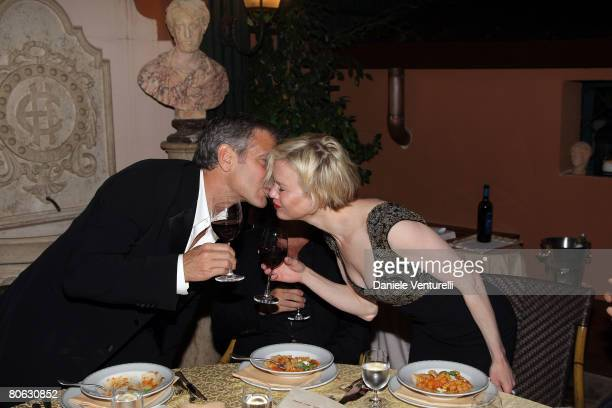 George Clooney, Manuele Malenotti and Renee Zellweger attends the 'Leatherheads' party at the Eden Hotel on April 10, 2008 in Rome, Italy.
