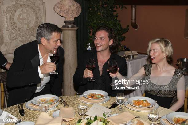 George Clooney Manuele Malenotti and Renee Zellweger attends the 'Leatherheads' party at the Eden Hotel on April 10 2008 in Rome Italy