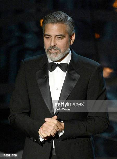 George Clooney presents onstage during the Oscars held at the Dolby Theatre on February 24 2013 in Hollywood California