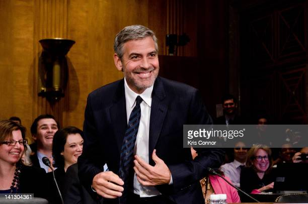 George Clooney smiles as he testifies at the Senate Foreign Relations Sudan and South Sudan Independence and Insecurity hearing at the Dirksen Senate...