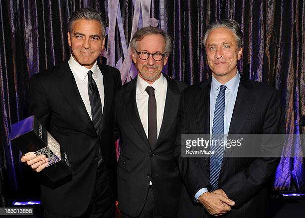 George Clooney Steven Spielberg and Jon Stewart attend the USC Shoah Foundation Institute 2013 Ambassadors for Humanity gala at the American Museum...