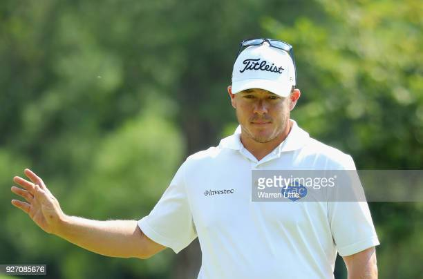 George Coetzee of South Africa acknowledges the crowd on the 12th green during the final round of the Tshwane Open at Pretoria Country Club on March...