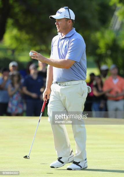 George Coetzee of South Africa acknowledges the crowd on the 18th green during the third round of the Tshwane Open at Pretoria Country Club on March...
