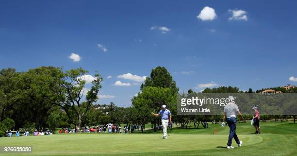 George Coetzee of South Africa acknowledges the crowd on the second green during the third round of the Tshwane Open at Pretoria Country Club on...