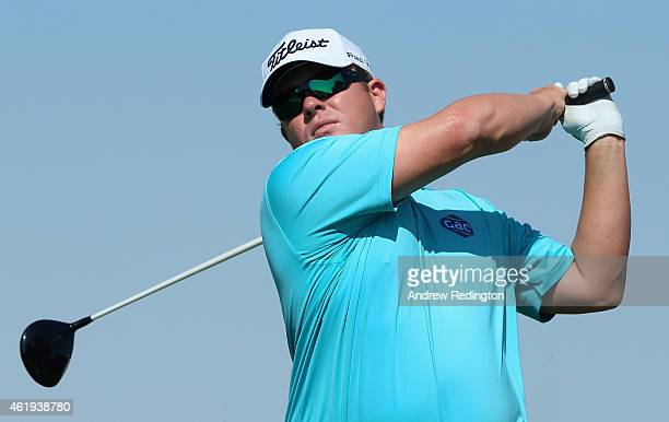 George Coetzee of South Africa hits his teeshot on the ninth hole during the second round of the Commercial Bank Qatar Masters at Doha Golf Club on...