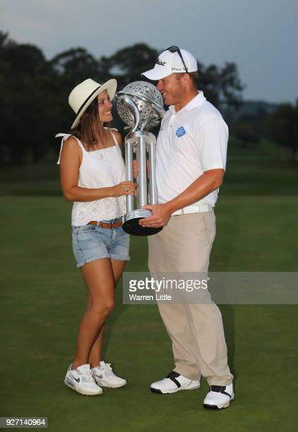 George Coetzee of South Africa is congratulated by his girlfriend Carli Jeanne Pohl after winning the Tshwane Open at Pretoria Country Club on March...