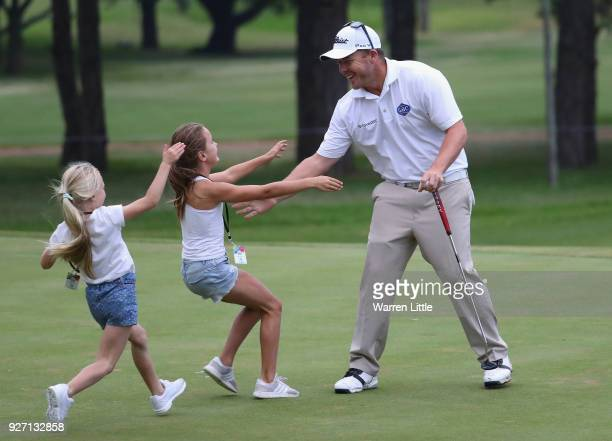 George Coetzee of South Africa is congratulated by his sisters on the 18th green after winning the Tshwane Open at Pretoria Country Club on March 4...