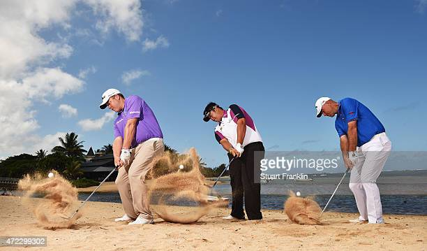 George Coetzee of South Africa Kiradech Aphibarnrat of Thailand and Thomas Bjorn of Denmark hits shots on the beach prior to the start of the AfrAsia...