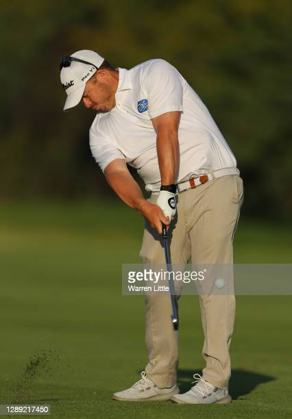 George Coetzee of South Africa plays his second shot on the 18th hole during Day One of the South African Open at Gary Player CC on December 03, 2020...